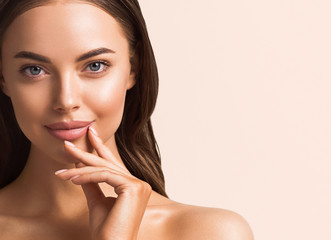 Beautiful woman hand touching skin manicure nails tanned skin natural make up clen fresh body care