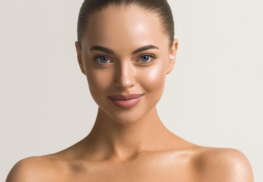 Beautiful woman face close up beauty make up natural healthy clean skin