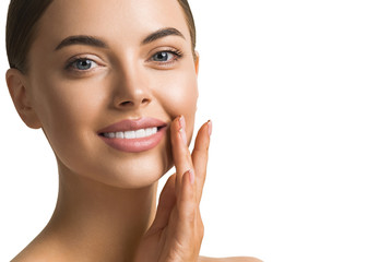 Beautiful teeth smile woman face hand manicure touching healthy skin and teeth isolated on white