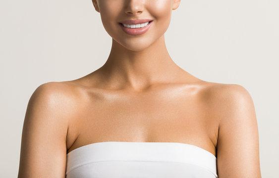 Beautiful woman teeth smile  neck shoulders lips healthy skin cosmetic tanned skin care female model