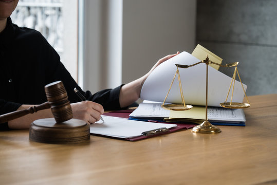 female lawyer working at the law firms. Judge gavel with scales of justice. Legal law, lawyer, advice and justice concept.