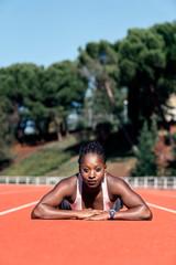 Athlete sprinter looking at camera