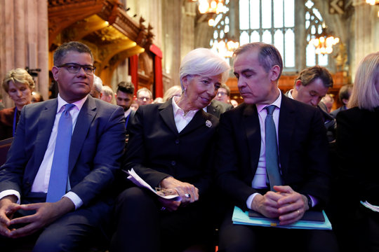 Mark Carney, Governor of the Bank of England, talks with President of the European Central Bank Christine Lagarde during an event to launch the private finance agenda for the 2020 United Nations Climate Change Conference (COP26) at Guildhall in London