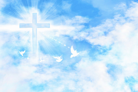 Cloudy blue sky with cross and doves flying