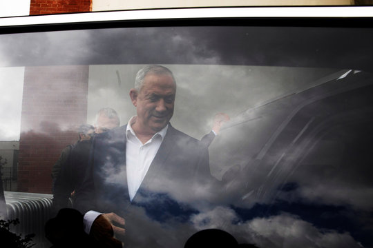 Benny Gantz, leader of Blue and White party, is seen through a car window after speaking at a regional council chairpersons' conference in Kiryat Anavim