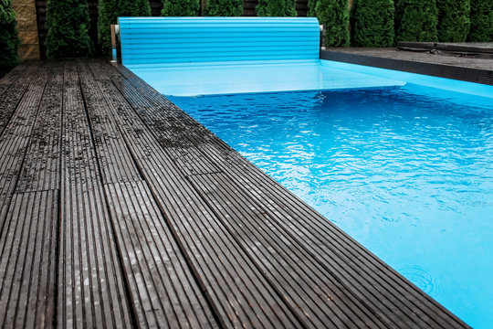Automatic swimming pool covering system, home and cottage equipment