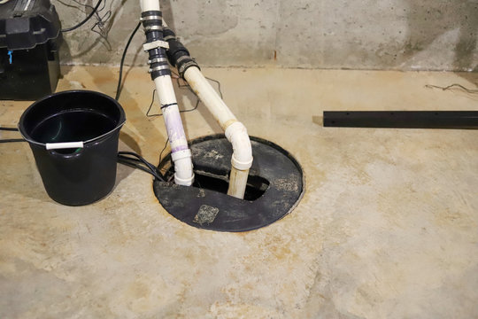 A sump pump in a  home basement-plumbing repair