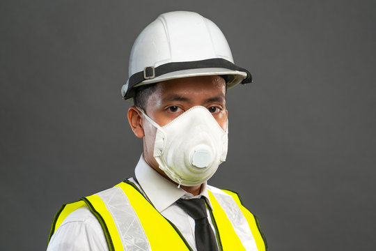 Construction worker wearing mask.