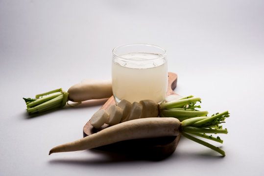 Healthy Fresh daikon juice or Mooli extract drink in a glass with raw mule