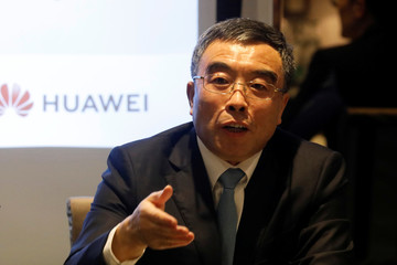 Liang Hua chairman of Huawei attends a news conference in Paris