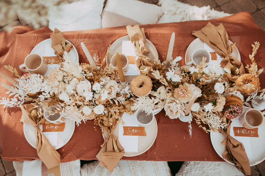 boho table scape with donuts