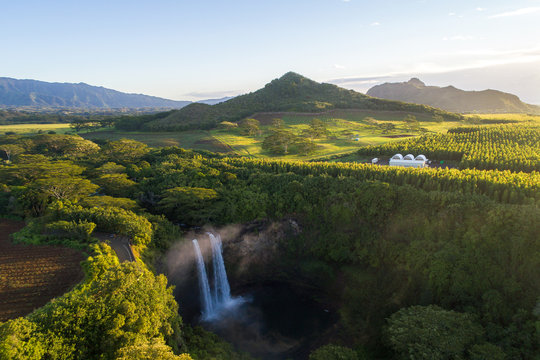Hawaiian waterfall in front of Mountains