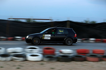 A driver competes during a drift car racing, organized by Palestinian motor sports federation, in Jericho in the Israeli-occupied West Bank