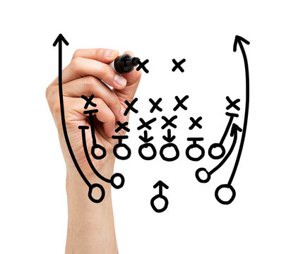 Coach drawing american football or rugby game playbook