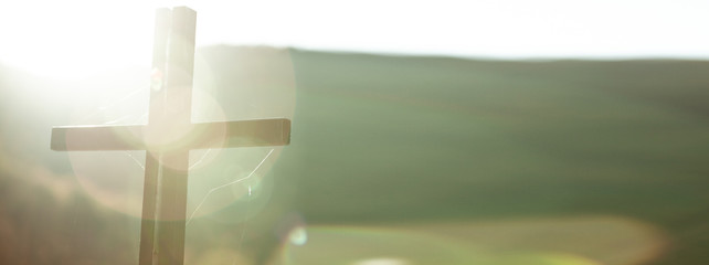 Fototapeta cross in nature at the sunset obraz