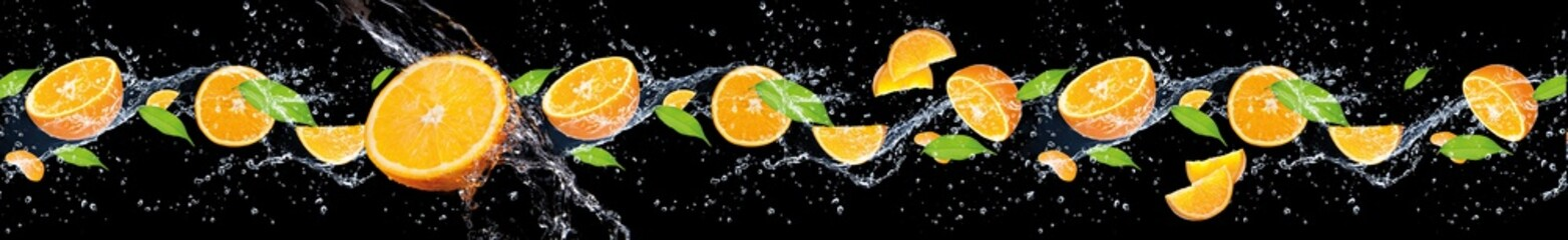 panorama of fruits in water on a black background