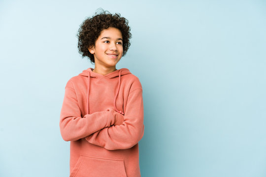 African american little boy isolated smiling confident with crossed arms.