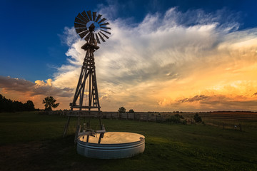 windmill at sunset before a storm