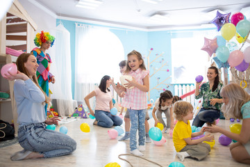 Little kids and their parents have fun on children birthday party