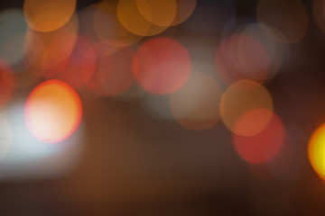 background of bokeh abstract colourful red, gold, blue and black glitter lights. defocused