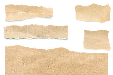 Recycled paper craft stick on a white background. Brown paper torn or ripped pieces of paper isolated on white background.