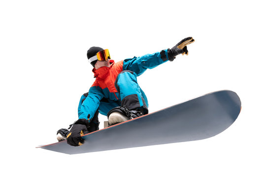 Portrait young man snowboarder jump on snowboard in sportswear isolated white background