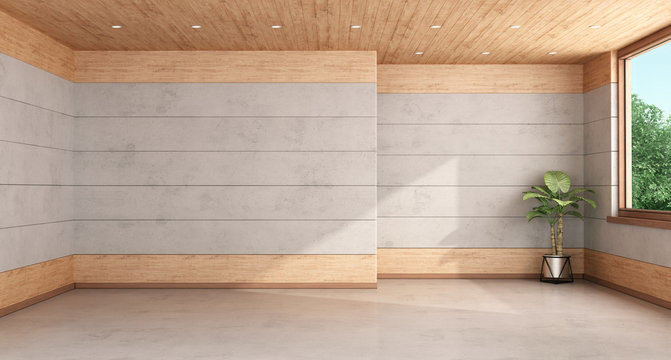 Empty room with concrete and wooden paneling