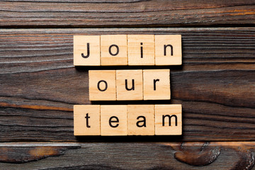 join our team word written on wood block. join our team text on table, concept