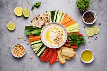 Hummus plate with a variety of vegetables and bread. Healthy snack or meze