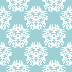 Floral seamless background. White design on blue backdrop