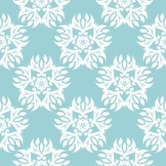 Floral seamless background. White design on blue backdrop