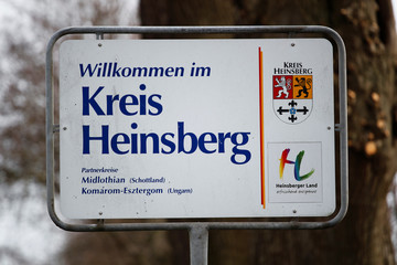 """A sign reading """"Welcome to the Heinsberg county"""" is pictured in the western German administrative district of Heinsberg, near Gangelt"""