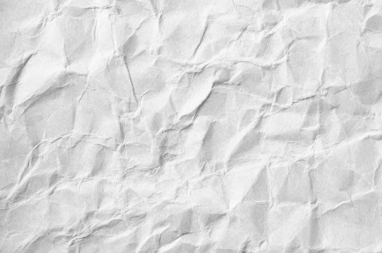 Creative background with scattered overlay of crumpled white paper.