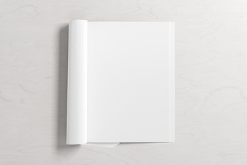 Blank vertical right magazine page. Workspace with folded magazine mock up on white desk. View above. 3d illustration