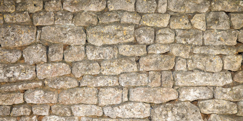 Old weathered stone wall of medieval fortress brick horizontal grunge background