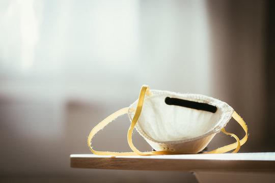 Breathing mask concept. White breathing mask protecting against flue and corona