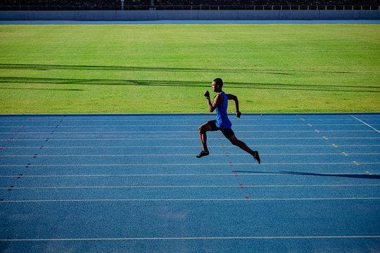 Athlete running at the stadium