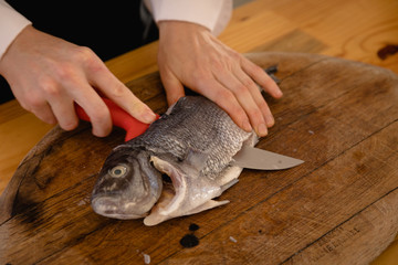 Chef cooking a fish