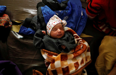 One-day-old baby is pictured after his mother Shabana Parveen and her family fled their home following clashes between people demonstrating for and against a new citizenship law in a riot affected area in New Delhi