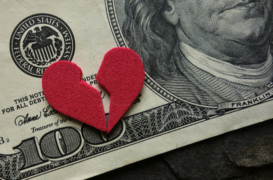 Cracked heart on money