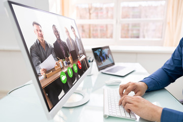 Businessman Video Conferencing With Team