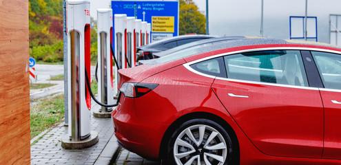 Tesla super charger station at highway in Germany. October 2019.