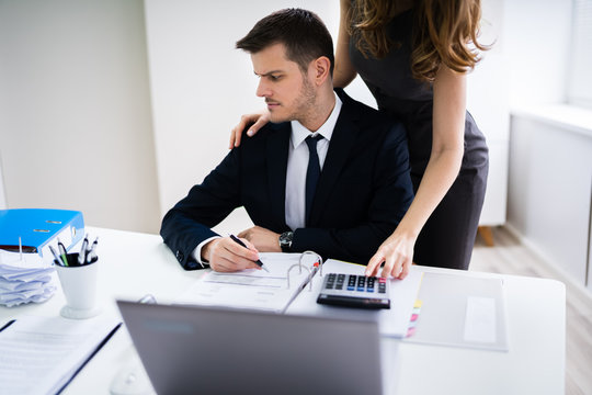 Businesswoman Flirting In Office