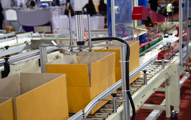 Production line of cardboard packing and sealing machine Fotomurales