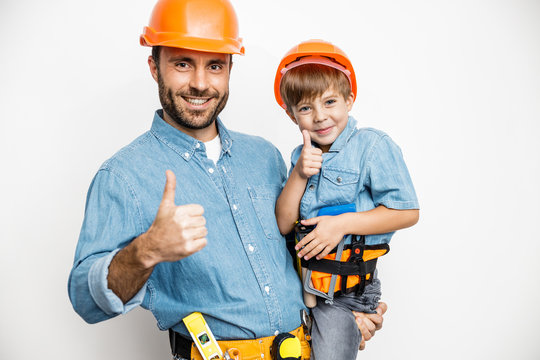Happy father with son mending flat stock photo