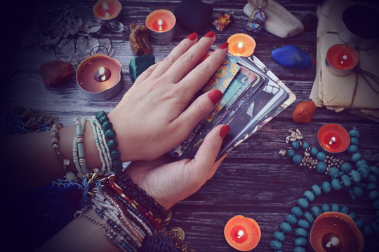 The woman is a psychic prophet. A psychic with Tarot cards. Guessing the future. Prediction of fate
