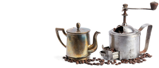 Vintage coffee pot, grinder coffee and beans isolated on white background. Free space for text. Wide photo.