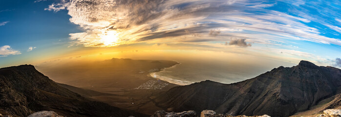 Photo sur Toile Iles Canaries Amazing summer sunset panorama over ocean resort beach Famara Lanzarote Canary Islands, Spain