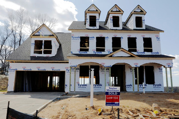 """A home under construction stands behind a """"sold"""" sign in a new development in York County, South Carolina"""