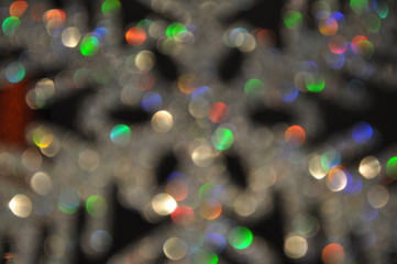 Shiny multicolor glitter background. Bokeh light effect.